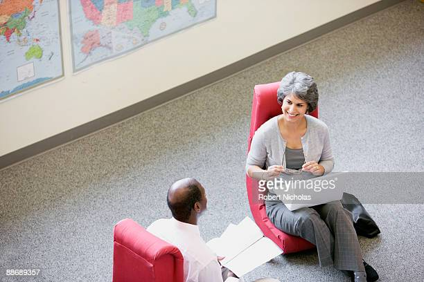 Business people having meeting in unconventional chairs