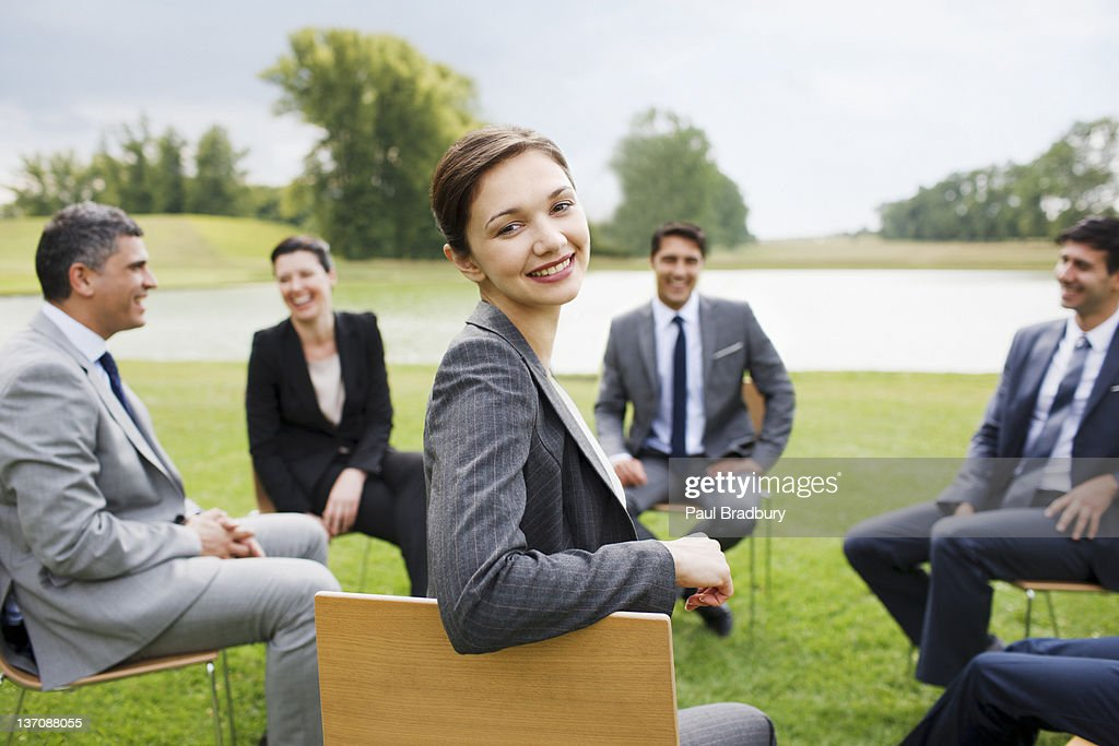 Business people having meeting outdoors : Stock Photo