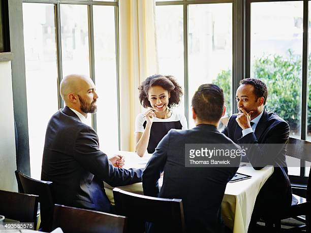 Business people having meeting over lunch