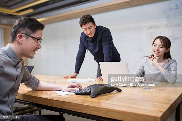 Business people having teleconference in board room