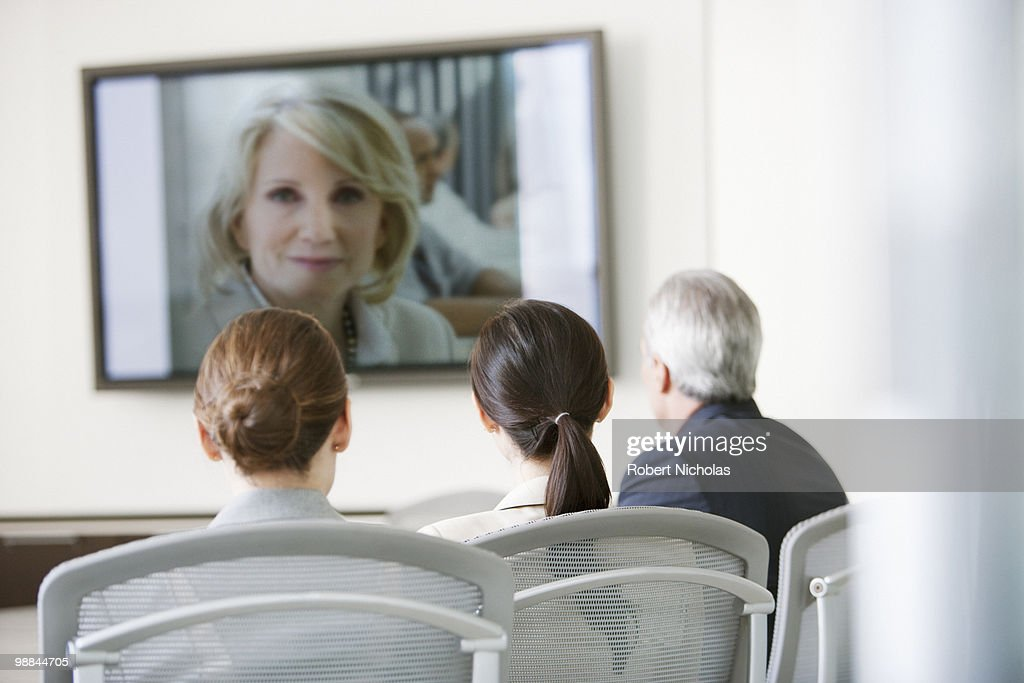 Business people having video conference in conference room : Stock Photo