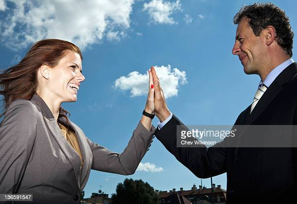 Business people high fiving outdoors