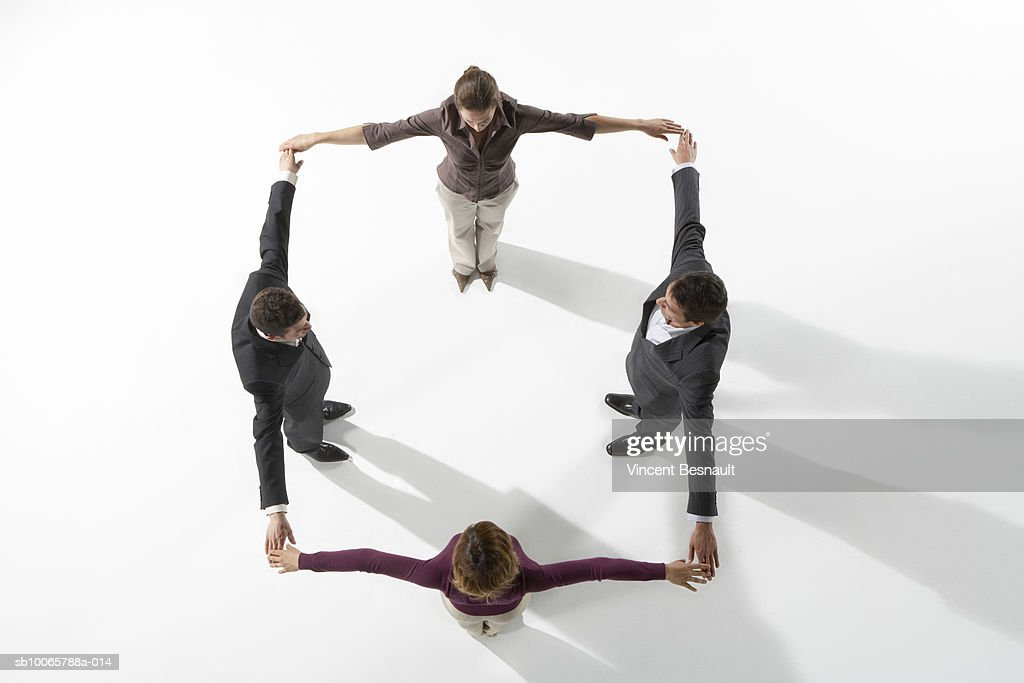Business people holding hands to create square formation : Stock Photo