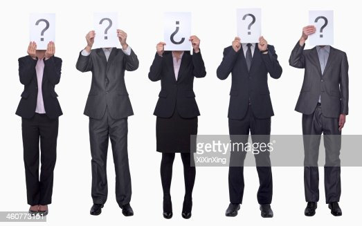 Business people holding up paper with question mark : Stock Photo