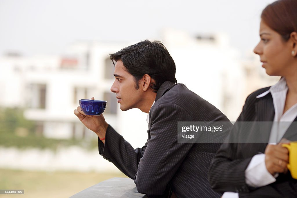 Business People In A Coffee Break Stock Photo | Getty Images