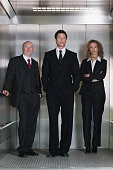 Business people in a lift