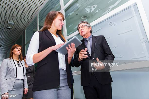 Business people in a lobby of an office building