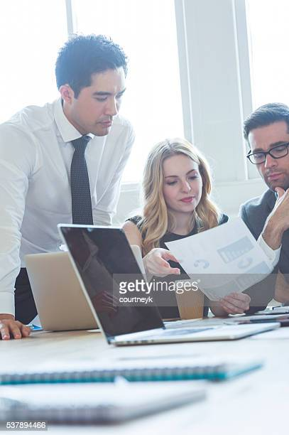 Business people in a meeting with technology