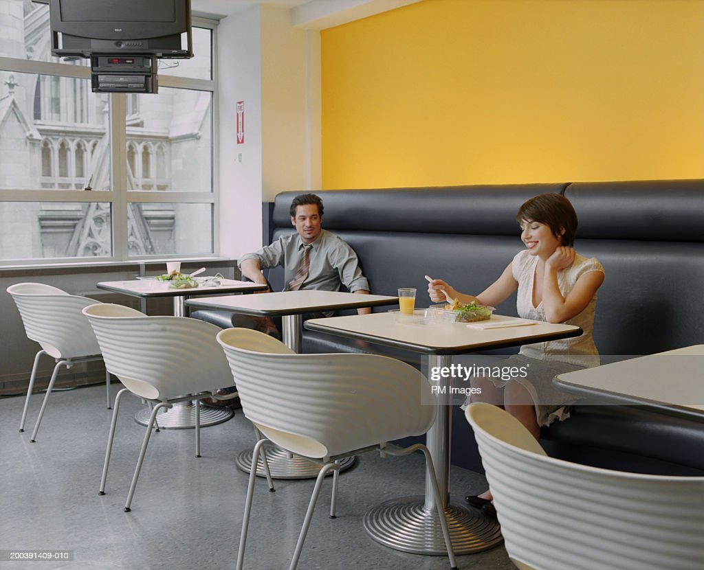 Business people in cafeteria : Stock Photo