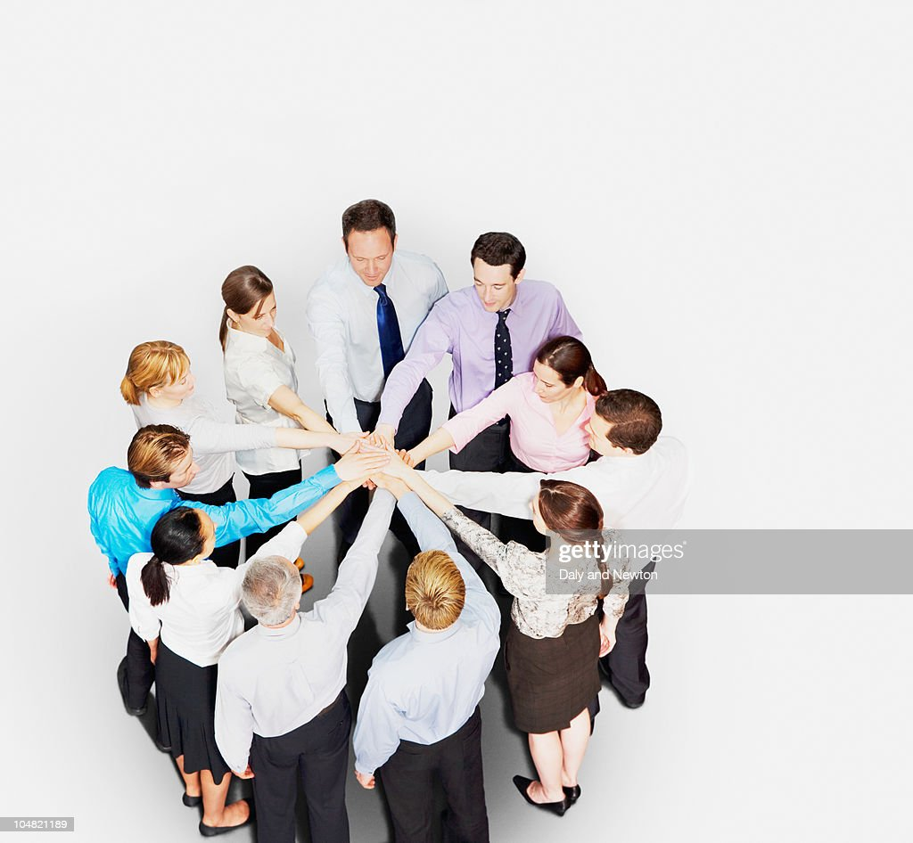 Business people in circle stacking hands : Stock Photo