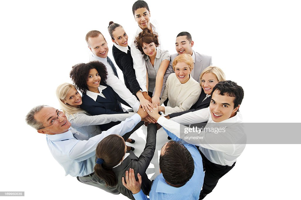 Business People in Circle with Hands at Center.