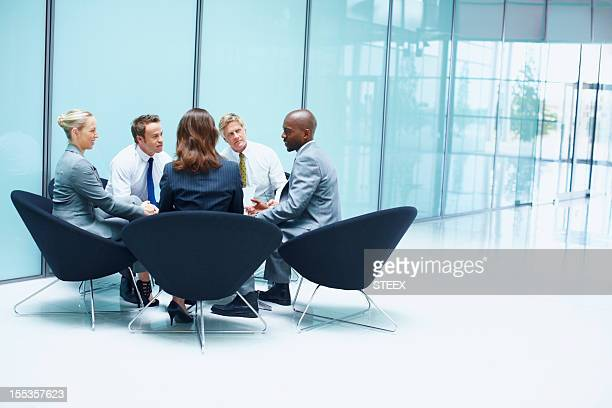 Business people in constructive discussion