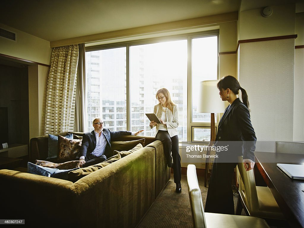 Business people in discussion in hotel suite : Stock Photo