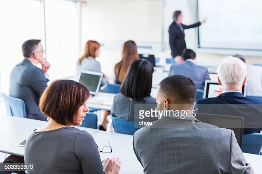 Business people in education room listening lecture of senior teacher