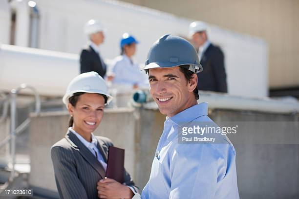 Business people in hard-hats outdoors