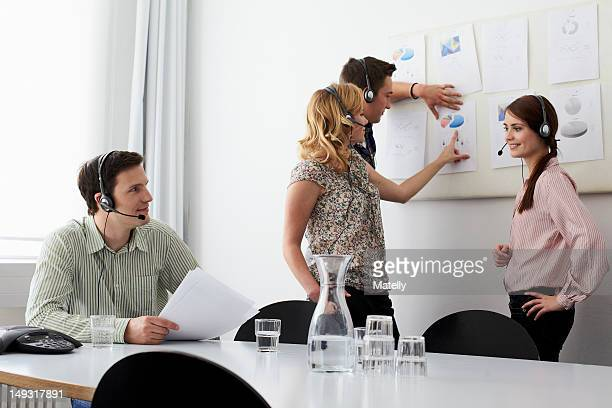 Business people in headsets in meeting