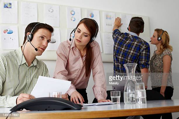 Business people in headsets in office