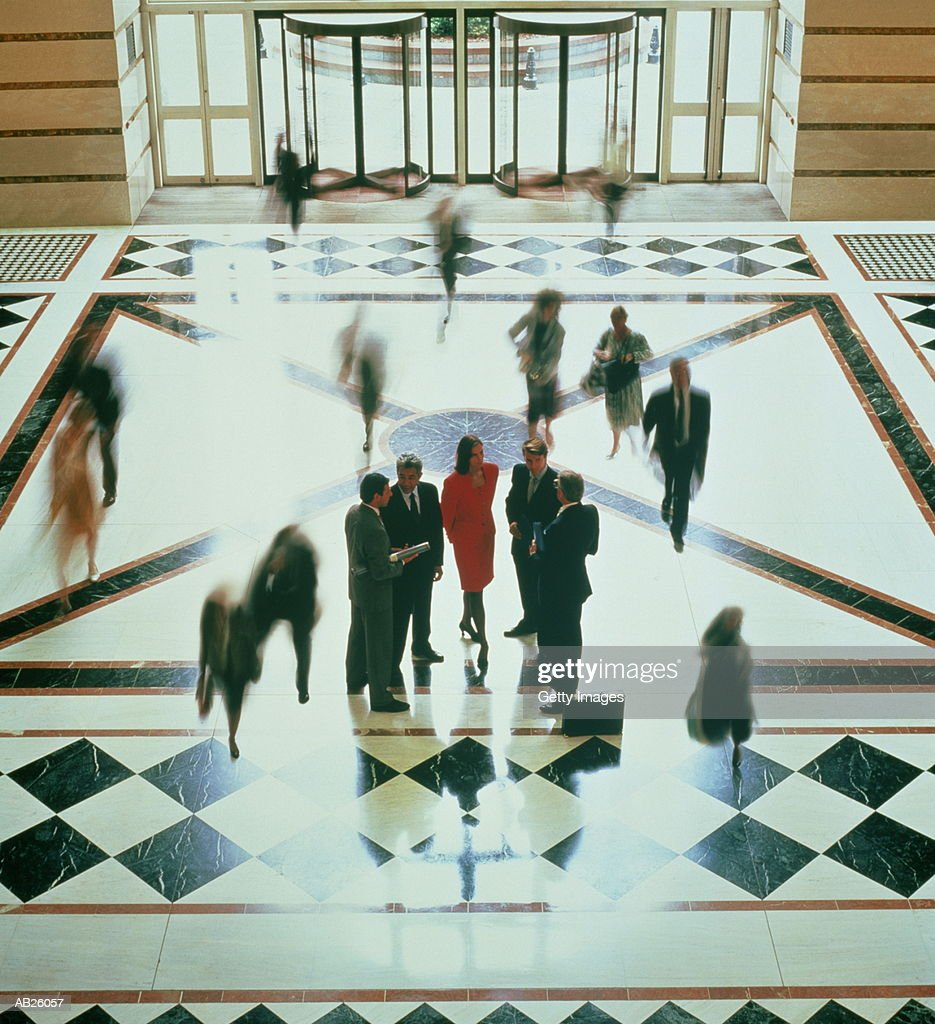 Business people in lobby of office building : Stock Photo