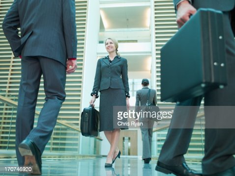 Business people in lobby : Stock Photo