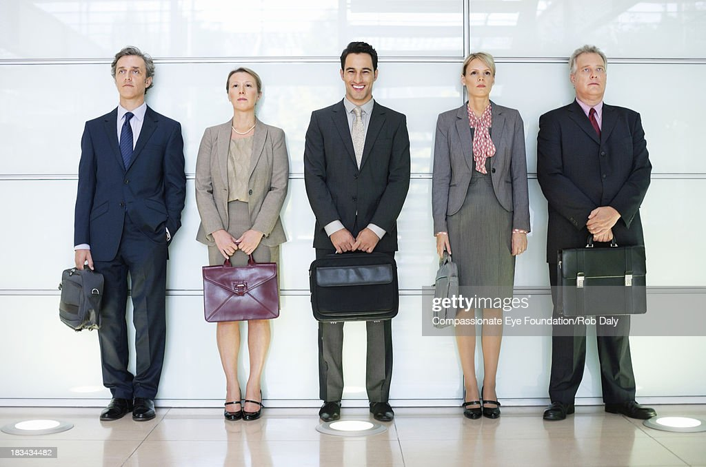 Business people in lobby standing in a line