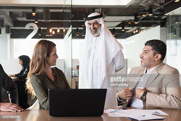 Business people in Middle Eastern office