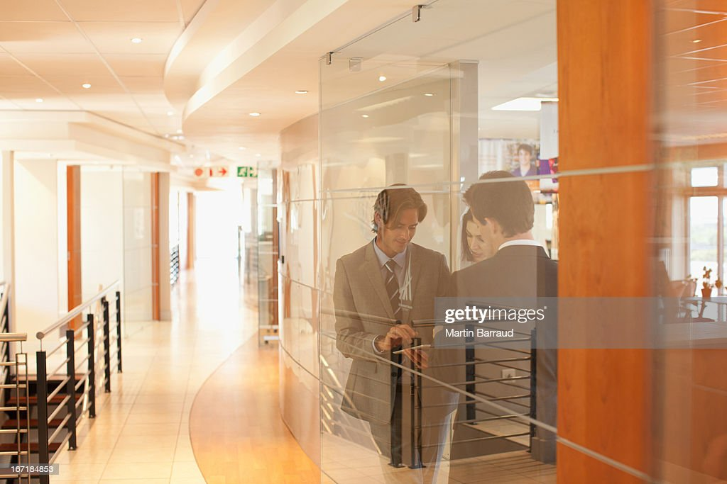 Business people in office window : Stock Photo