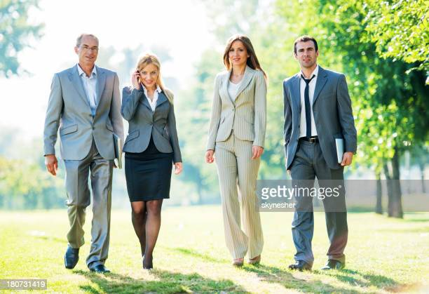Business people in park.