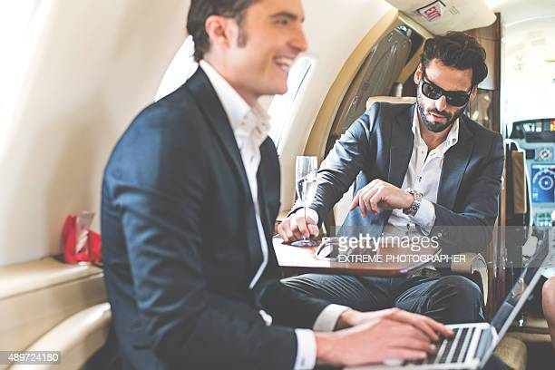 Business people in private jet airplane