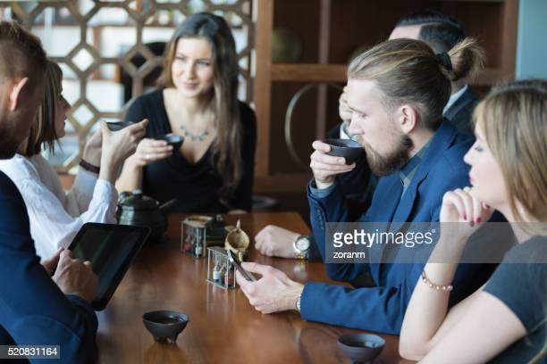 Business people in restaurant drinking tea