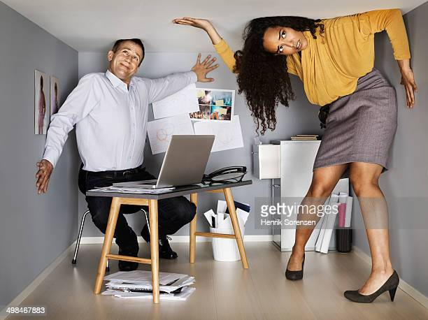 2 business people in small office