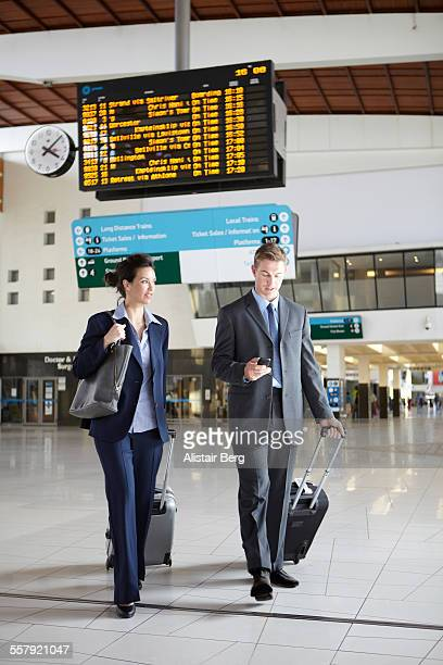 Business people in station foyer