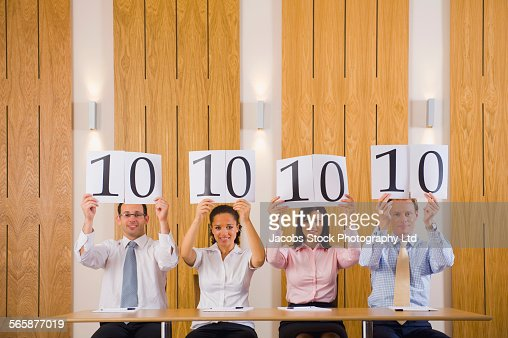 Business people judges giving high rating in competition