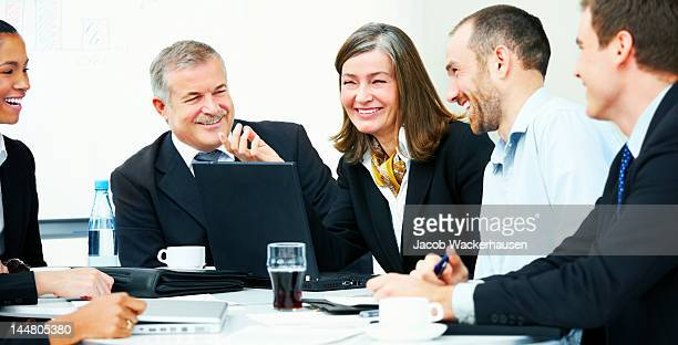 Business people laughing in a meeting
