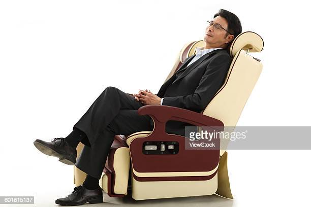Business people lean on the chair.