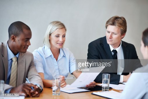Business people looking at resume