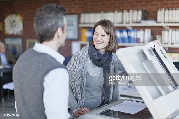 Business people making copies at work