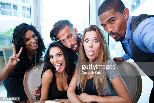 Business people making faces in office