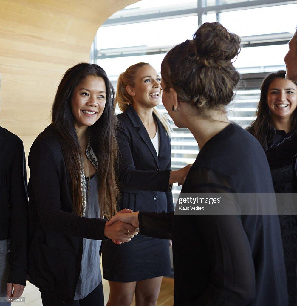 Business people making handshakes before meeting