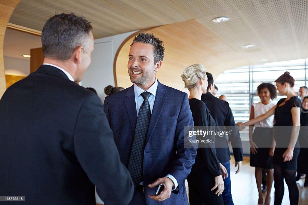 Business people making handshakes