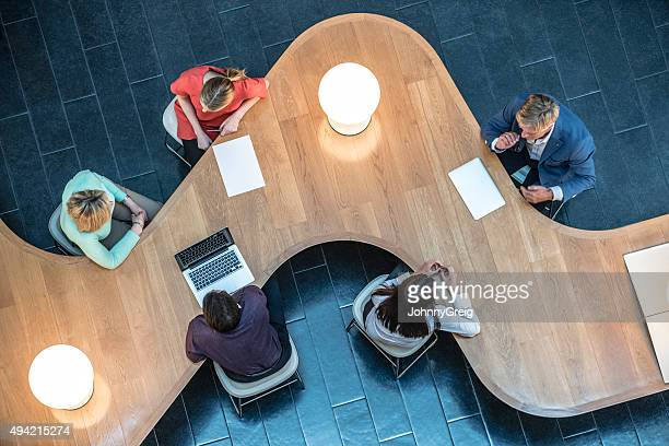Business people meeting in modern office, view from above.