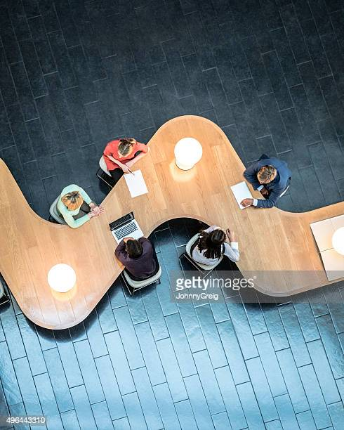 Business people meeting in modern office, view from above