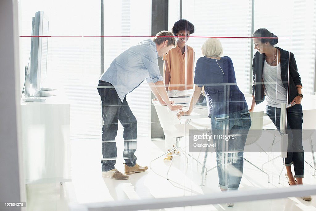 Business people meeting in sunny conference room : Stock Photo