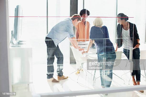 Business people meeting in sunny conference room