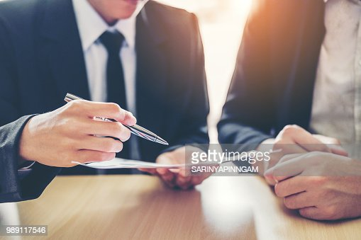 Business people Meeting negotiating a contract between two colleagues : Stock Photo