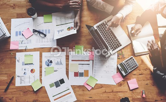 Business People Meeting using laptop computer, calculator, notebook, stock market chart paper for analysis Plans to improve quality next month. Conference Discussion Corporate Concept : Stock Photo