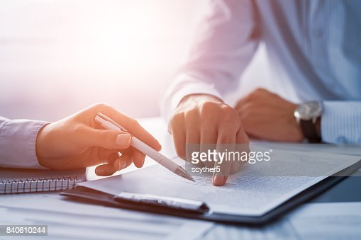 Business people negotiating a contract. : Stock Photo