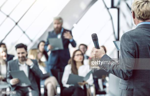 Business People on a Conference Event Listening To The Talker