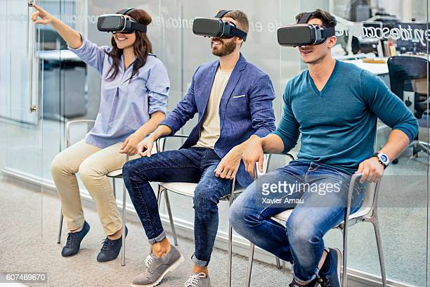 Business people on a meeting using  VR headset at office