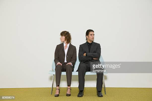 Business people on bench in waiting room