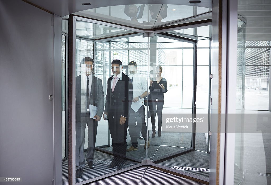 Business people on the way out of revolving door & Revolving Door Stock Photos and Pictures | Getty Images Pezcame.Com